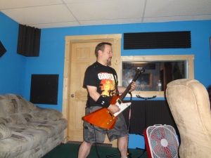 Mean Gene ripping up some scratch guitar tracks with Brucifer drumming behind that door.